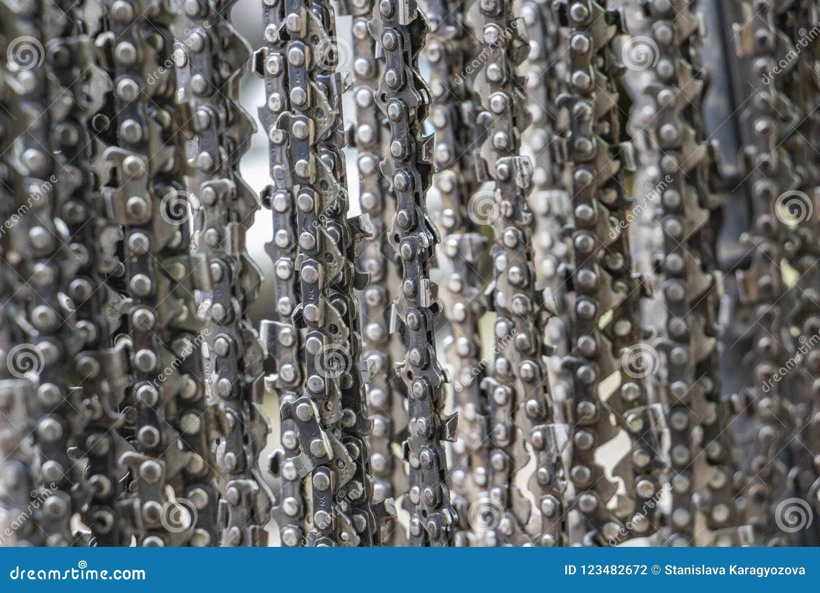 Chaînes accrochantes de tronçonneuse, fond de texture