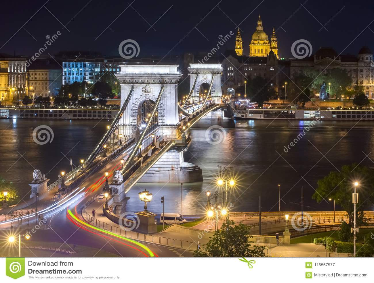 Chain Bridge over Danube river and St. Stephen`s Basilica at night, Budapest, Hungary