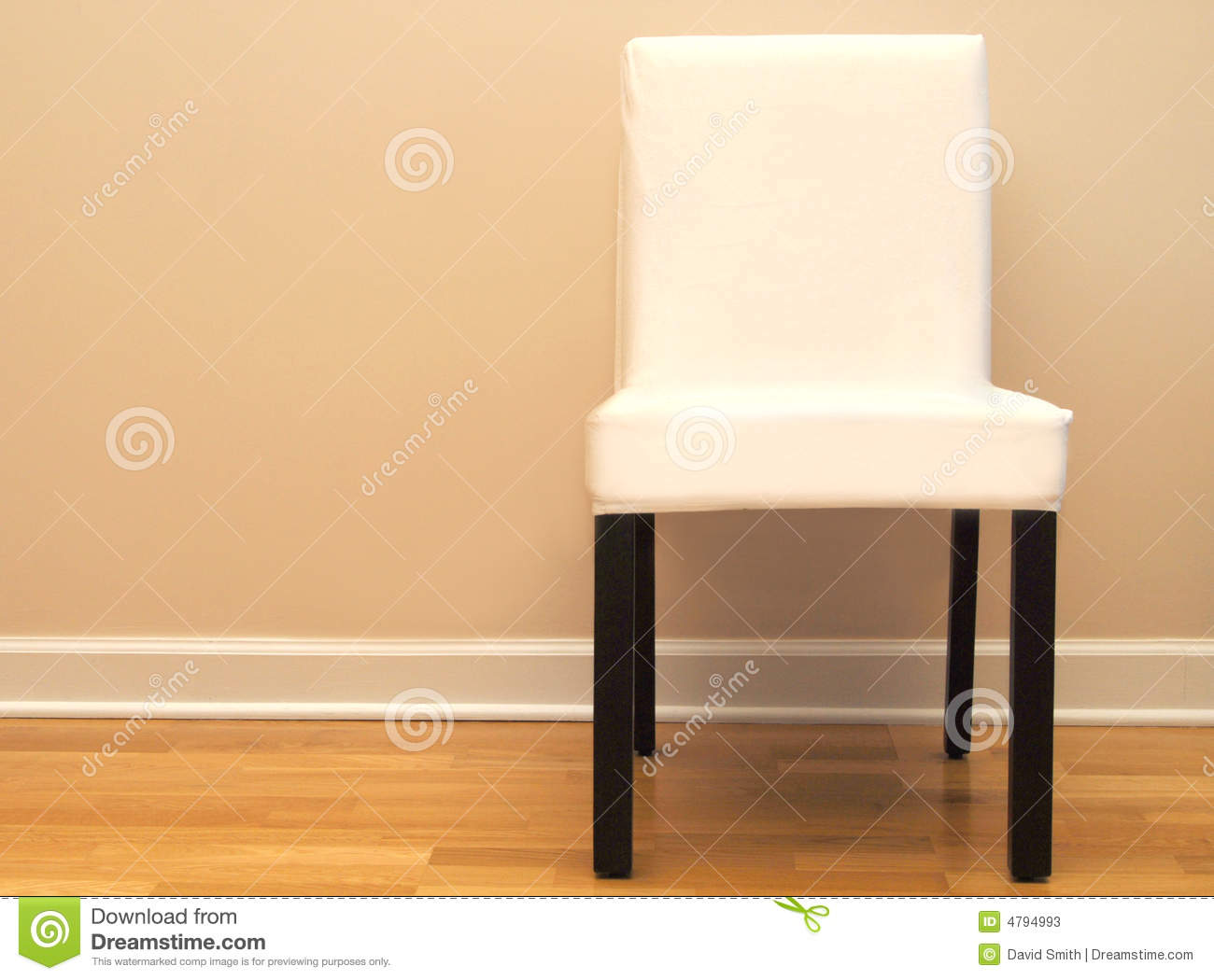 chair against a beige wall in a home stock photos image 4794993. Black Bedroom Furniture Sets. Home Design Ideas