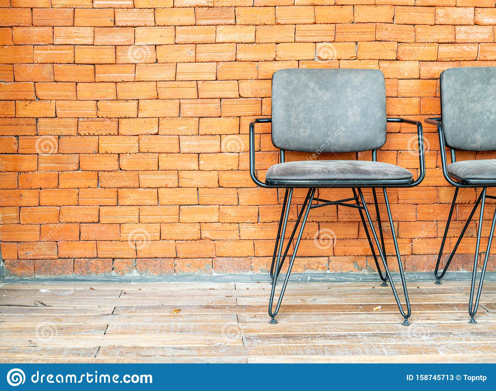 chair with brick wall