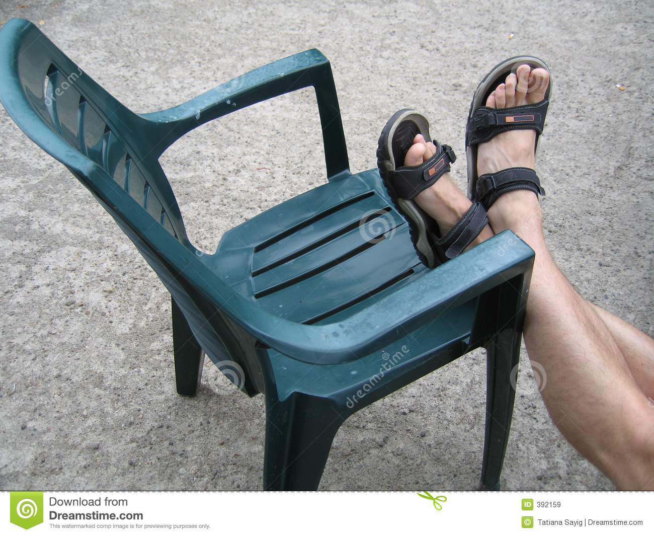Chair with feet on it stock image. Image of legs, floor - 392159