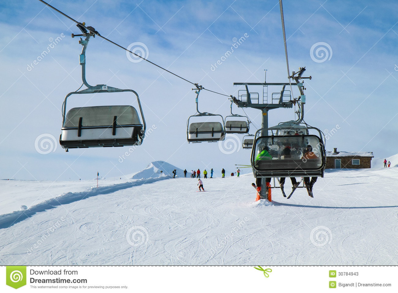Chair lift with three skiers stock photos image 30784943 for Moderne skihotels