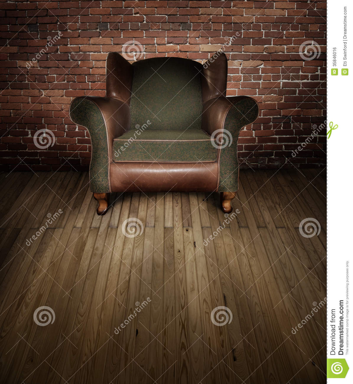 A Leather And Fabric Chair Backlit On A Wooden Stage With Red Brick  Backdrop. Concept For Interview.