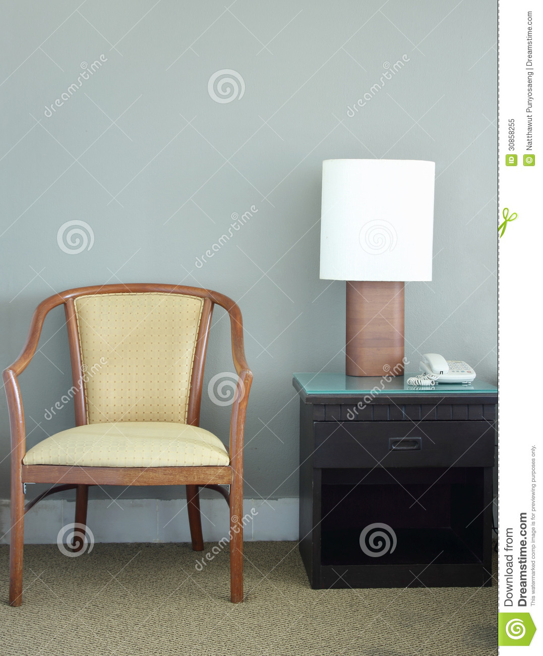 chair and table lamp in bedroom royalty free stock photo
