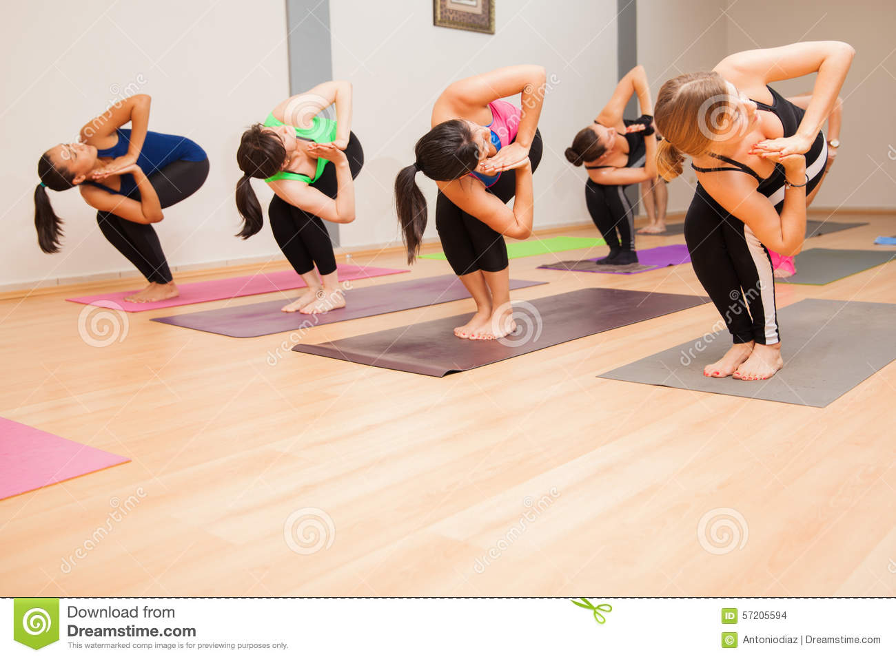 Chair Twist Pose In A Yoga Class Stock Photo Image 57205594
