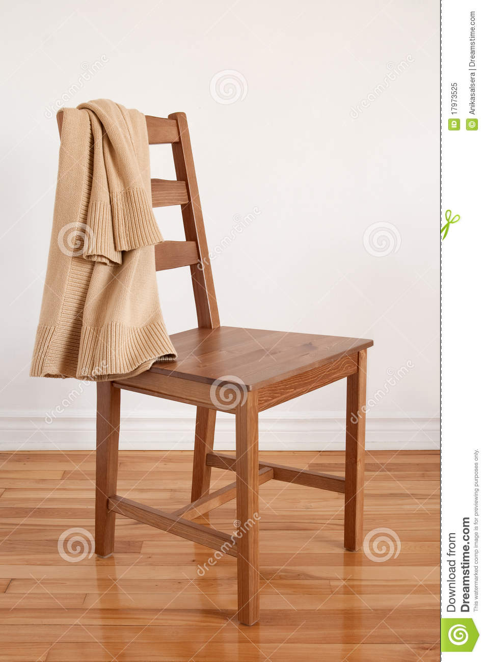 Chair On Wooden Floor With Clothing Over Its Back Royalty Free Stock ...