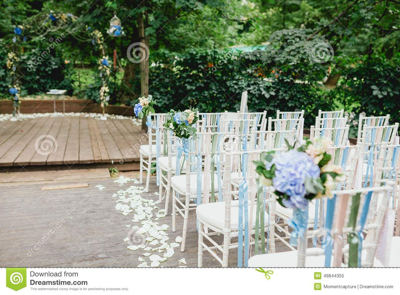 Chairs And Arch From Wedding Ceremony Stock Photo