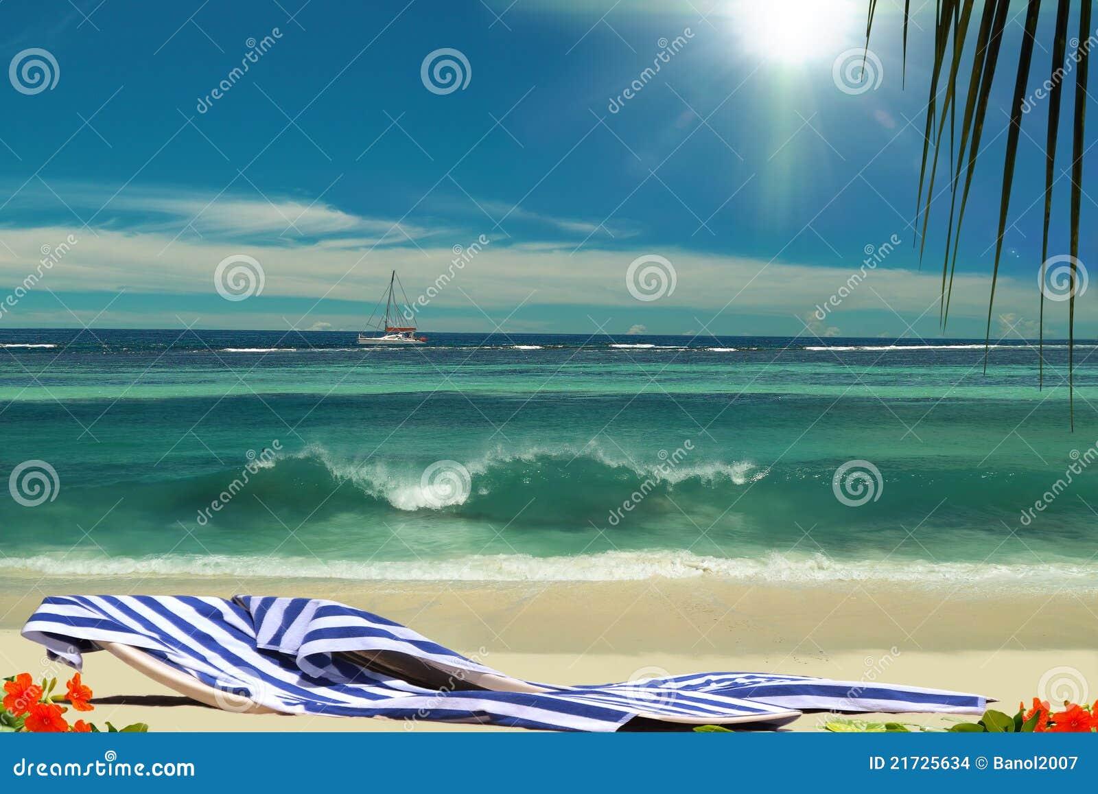 Chairs on beautiful sunshining paradise beach.