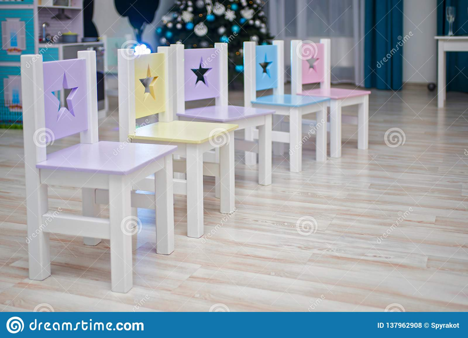 Chairs in children`s room. Kids room Interior. Chairs in kindergarten preschool classroom. Many brightly colored chairs for