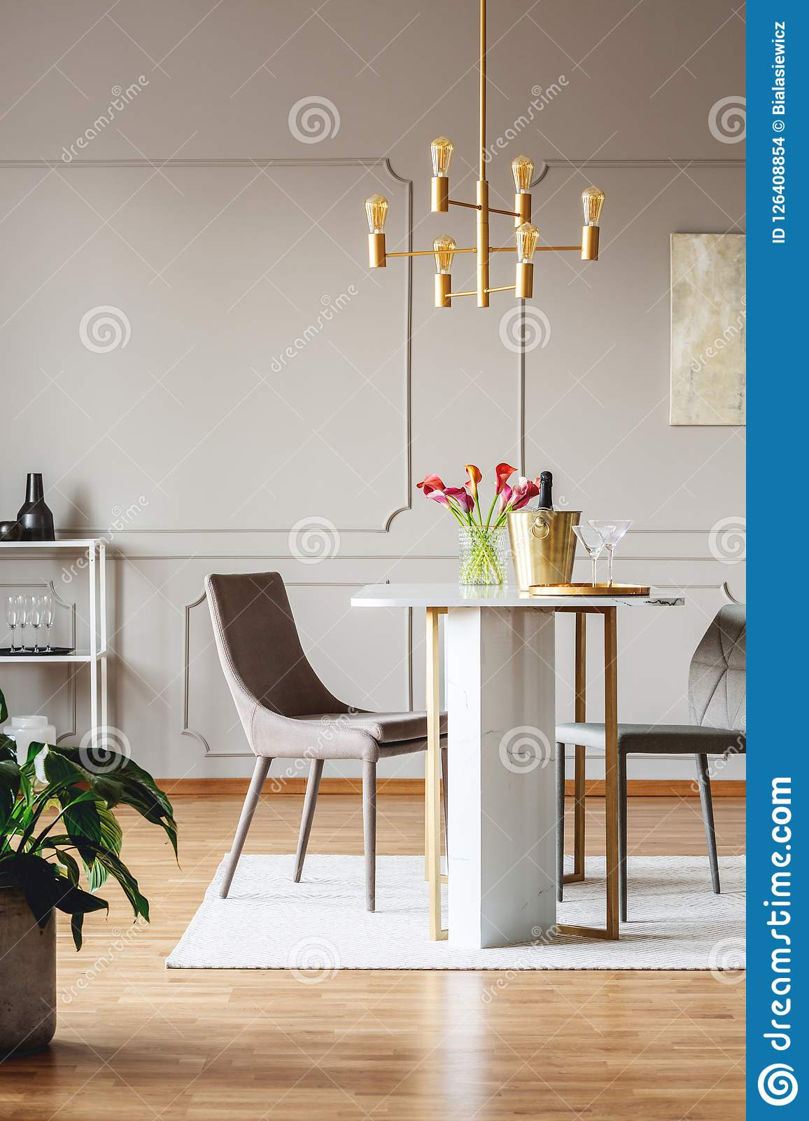 Fine Chairs At Dining Table With Flowers In Bright Apartment Machost Co Dining Chair Design Ideas Machostcouk