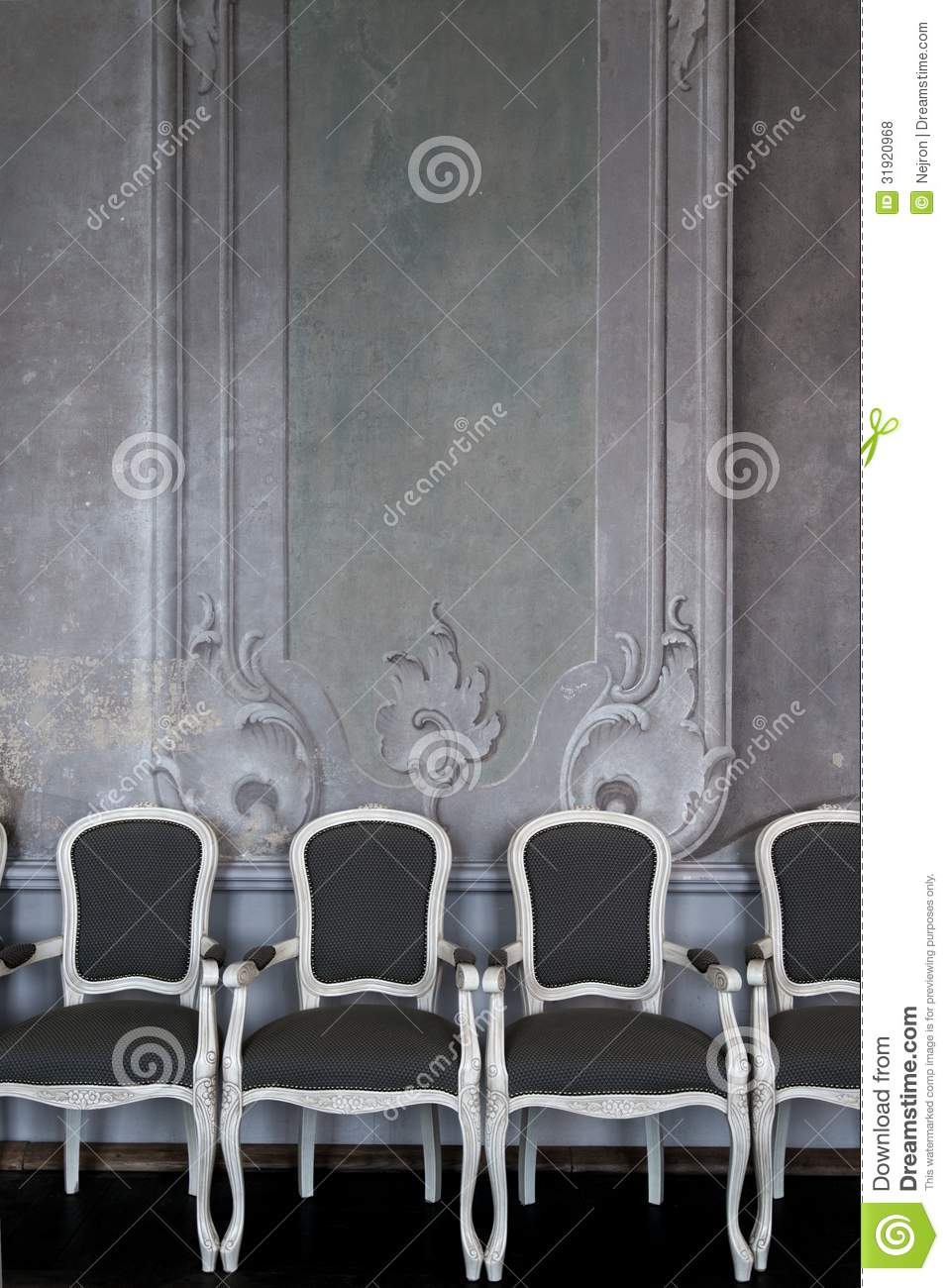 chairs near wall royalty free stock photos image 31920968. Black Bedroom Furniture Sets. Home Design Ideas