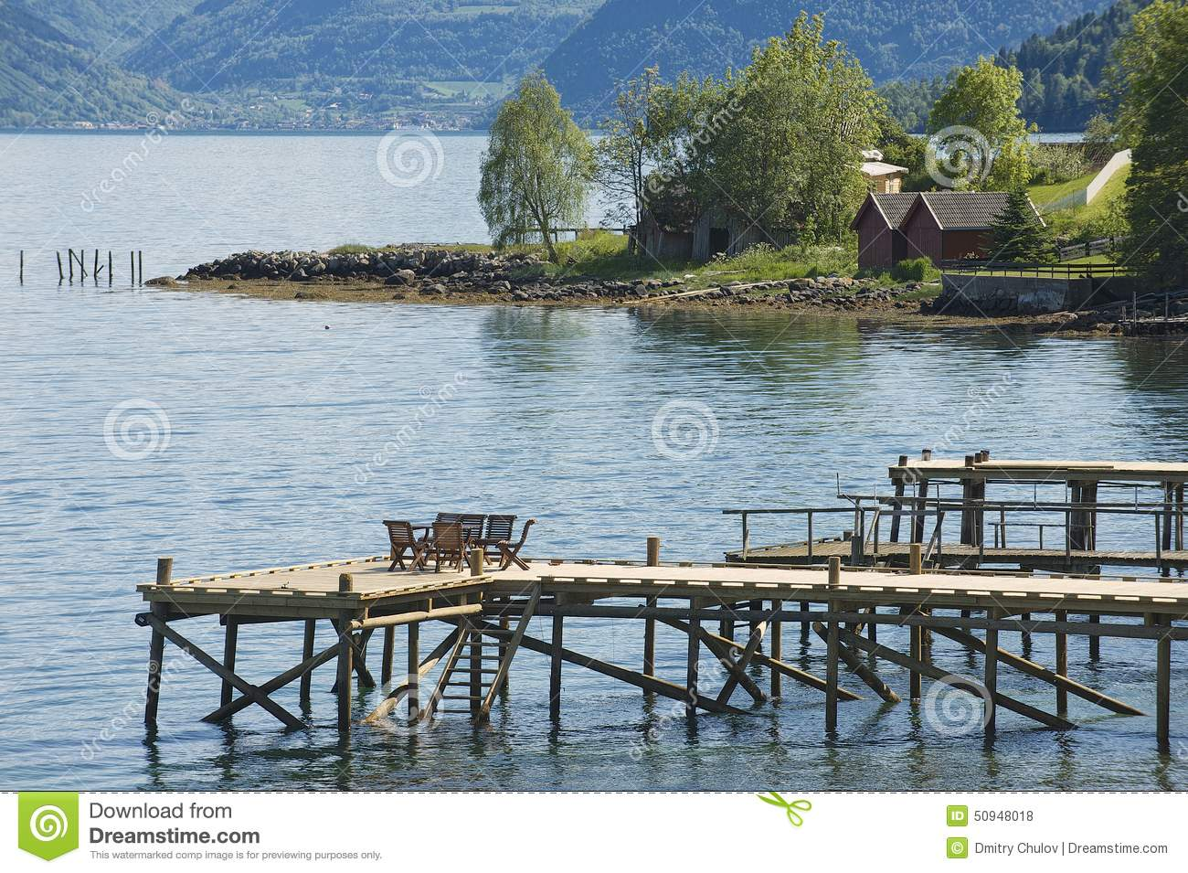 Download Chairs At The Pier Of A Fjord In Balestrand, Norway. Stock Photo
