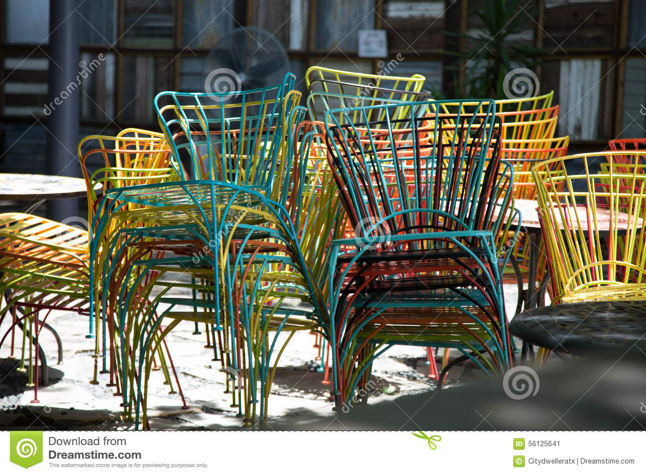 Magnificent Chairs Stacked At Outdoor Restaurant Stock Image Image Of Squirreltailoven Fun Painted Chair Ideas Images Squirreltailovenorg