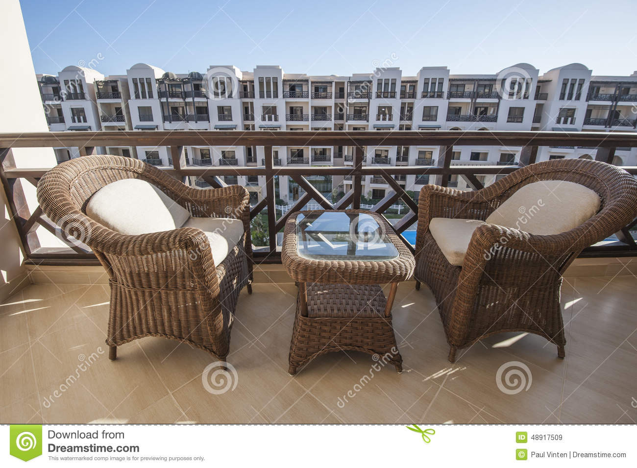 Chairs And Table On Balcony