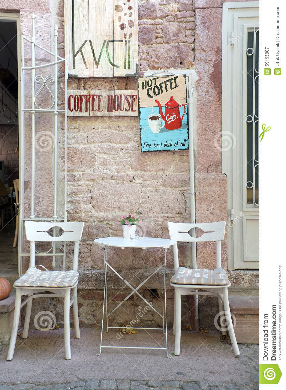 chairs and table outside of a little coffee shop editorial