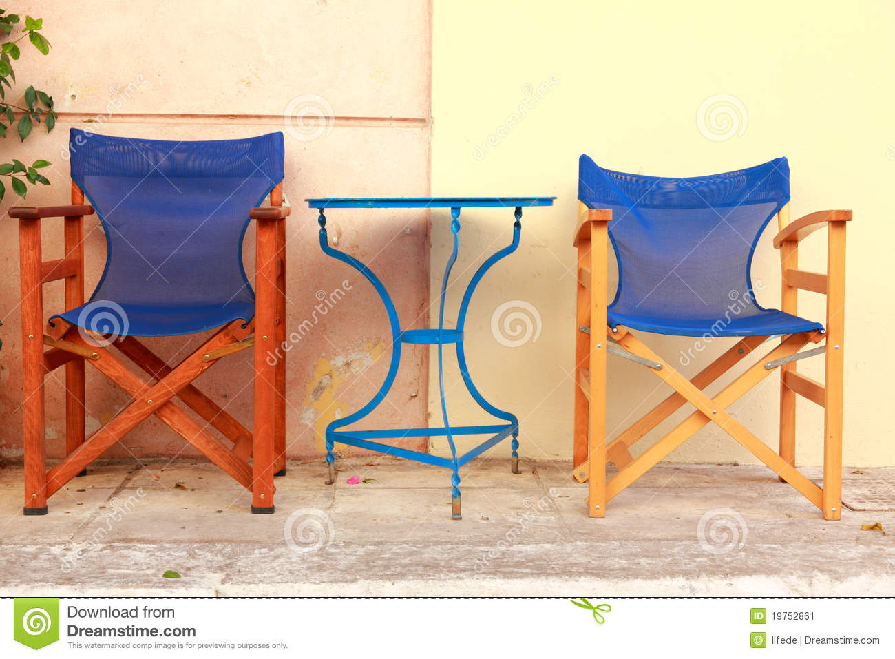 Outdoor cafe blue chairs and tables in athens street greece