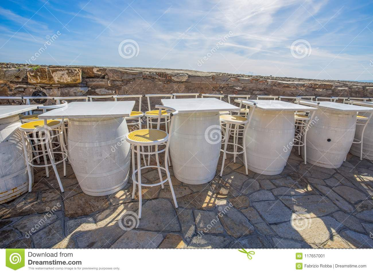 Chairs And White Tables Made Of Wine Barrels An Outdoor Restaurant