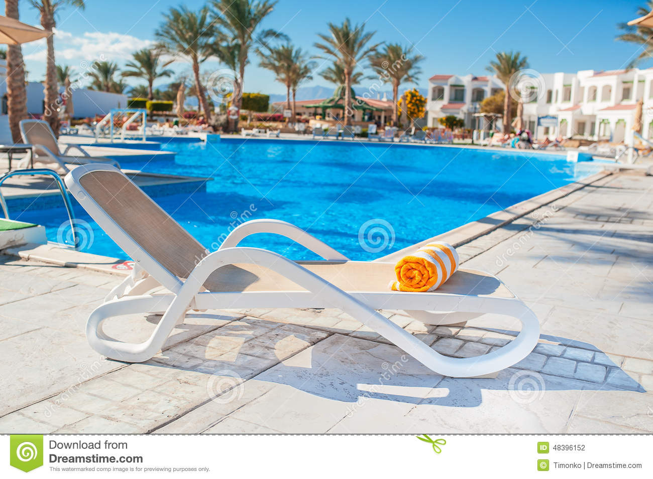 Chaise longue on the background of the pool at the hotel for Chaise longue design piscine