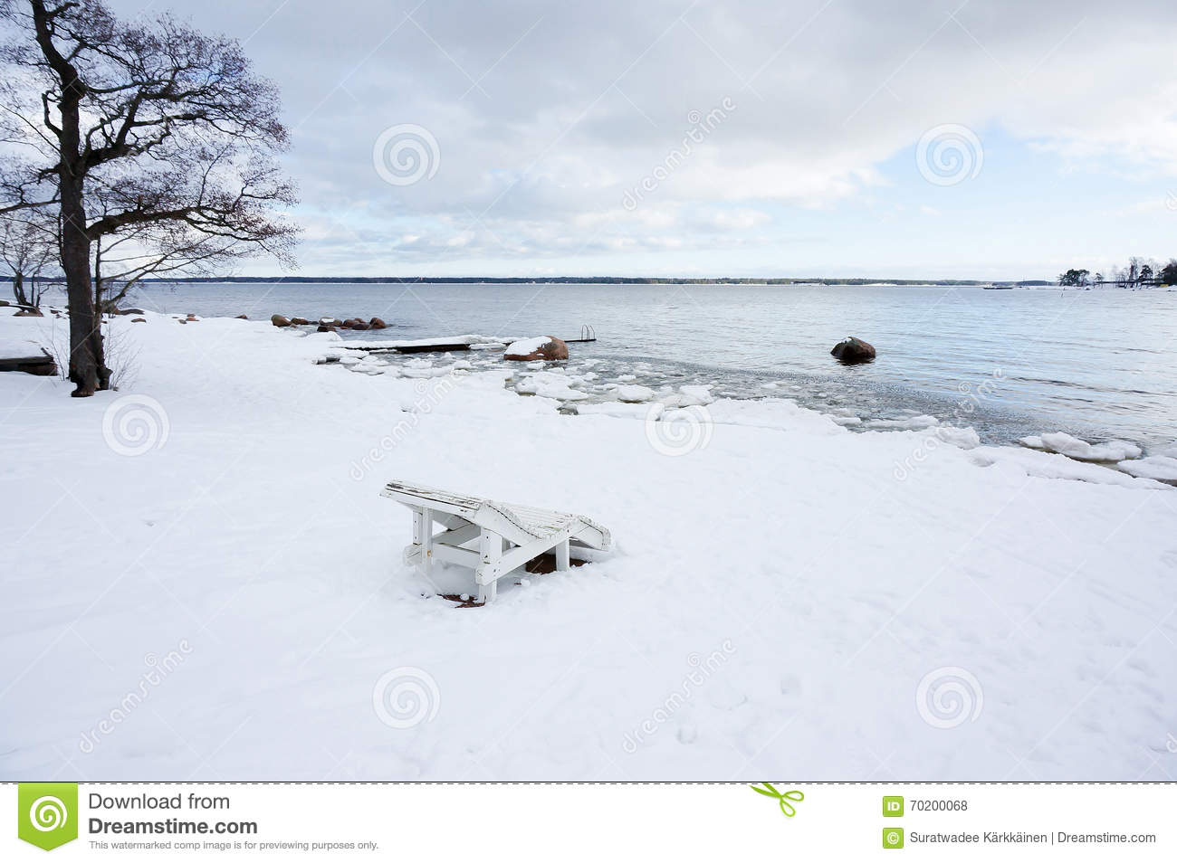 Chaise longue on the snowed beach stock photo image for Beach chaise longue