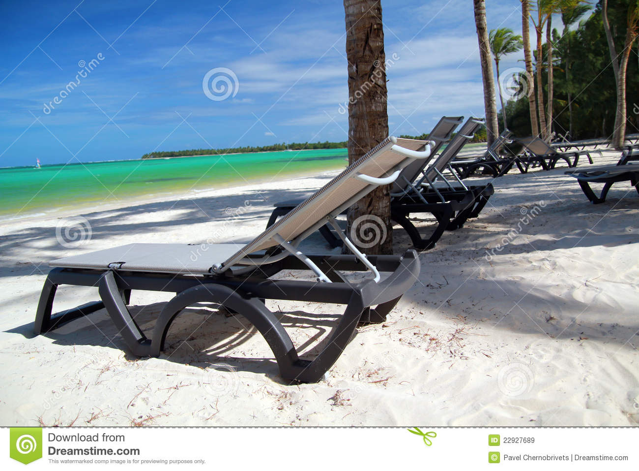 Chaise longues on tropical beach royalty free stock images for Beach chaise longue