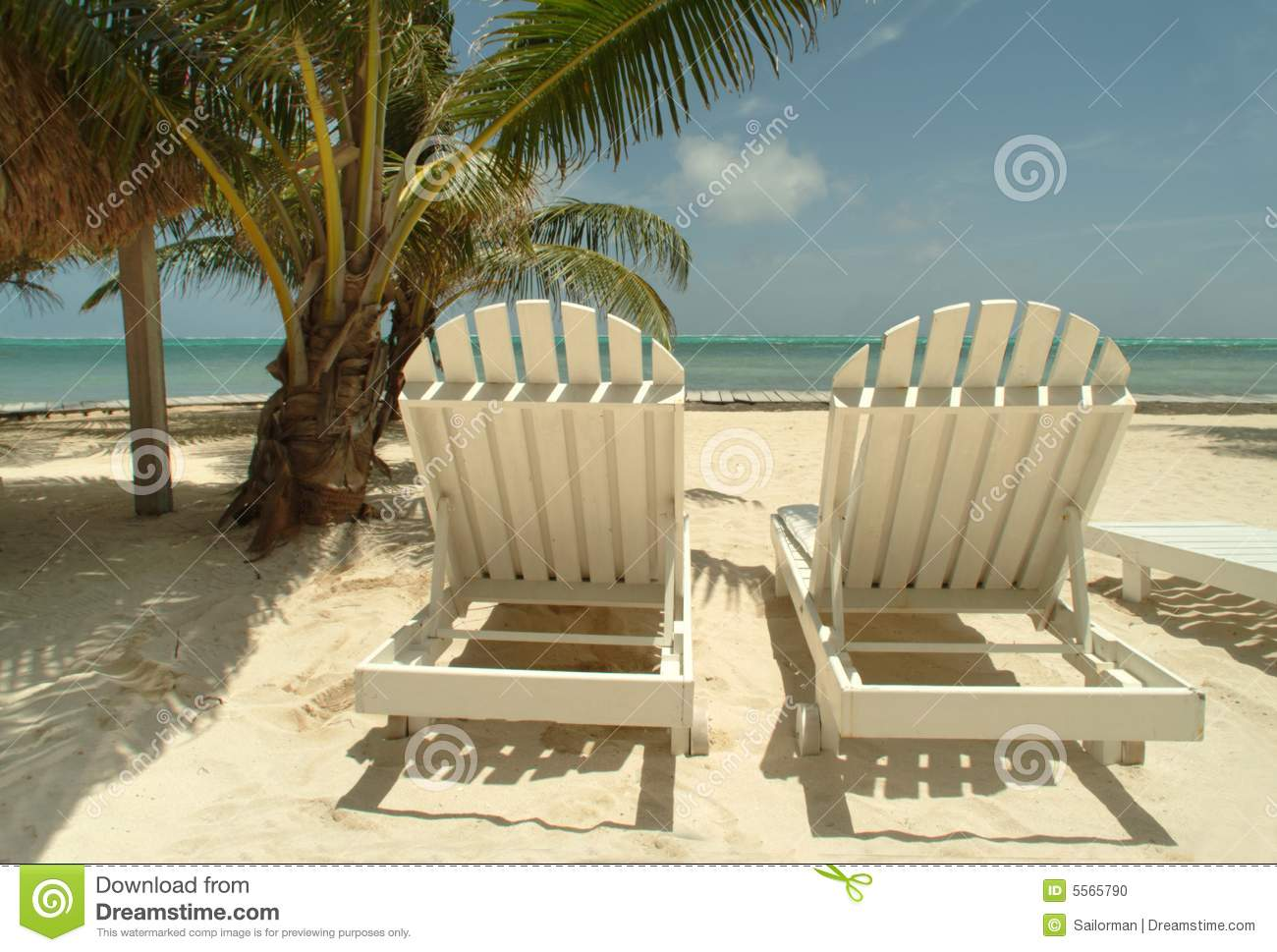 High Quality Chaise Lounge Chairs On A Tropical Beach.