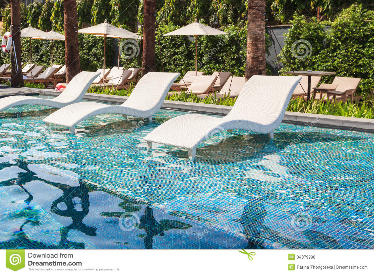Chaise Lounge In Swimming Pool Stock Image