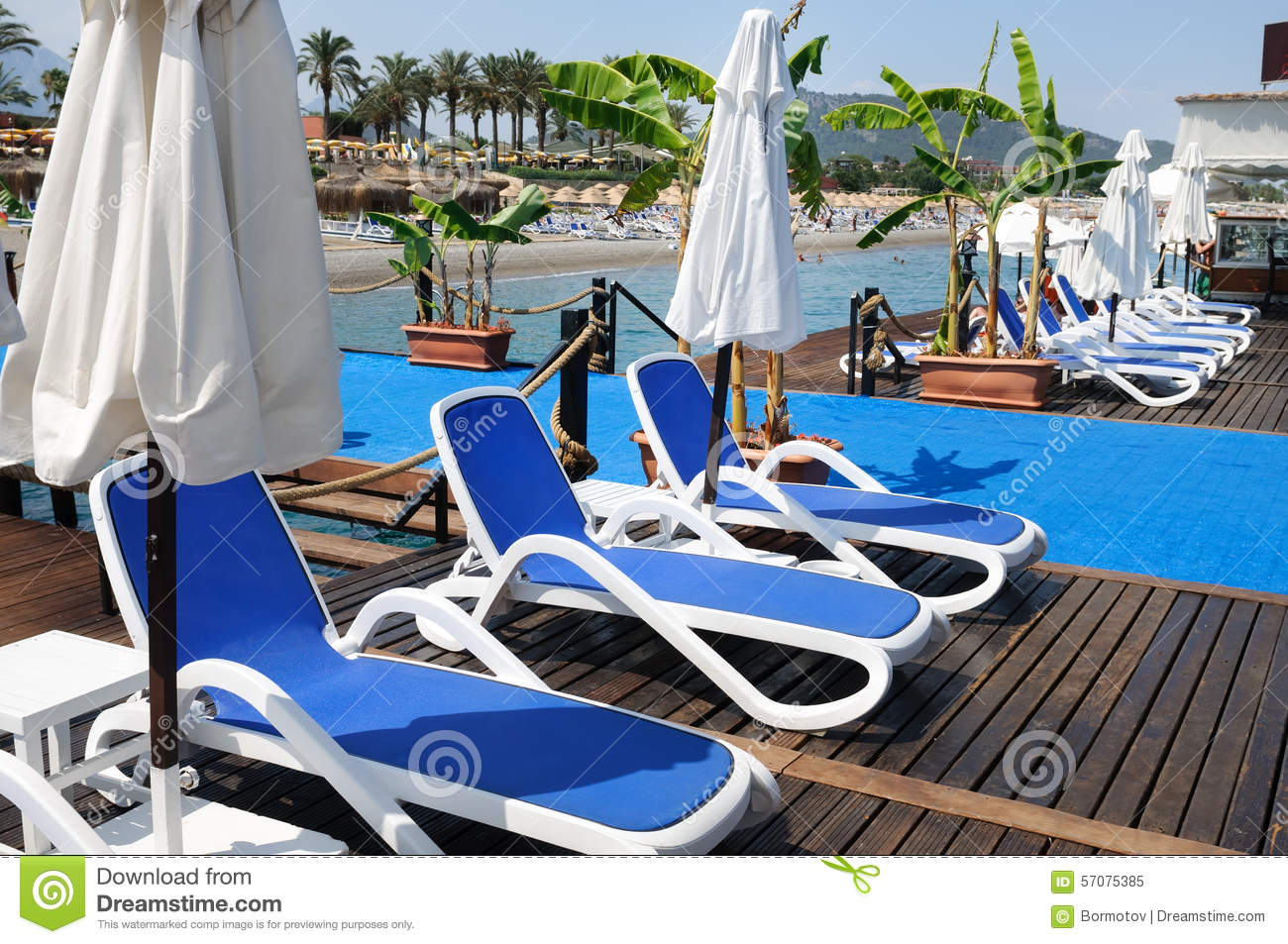 Chaise lounges from the sun on a beach stock photo image for Beach chaise longue