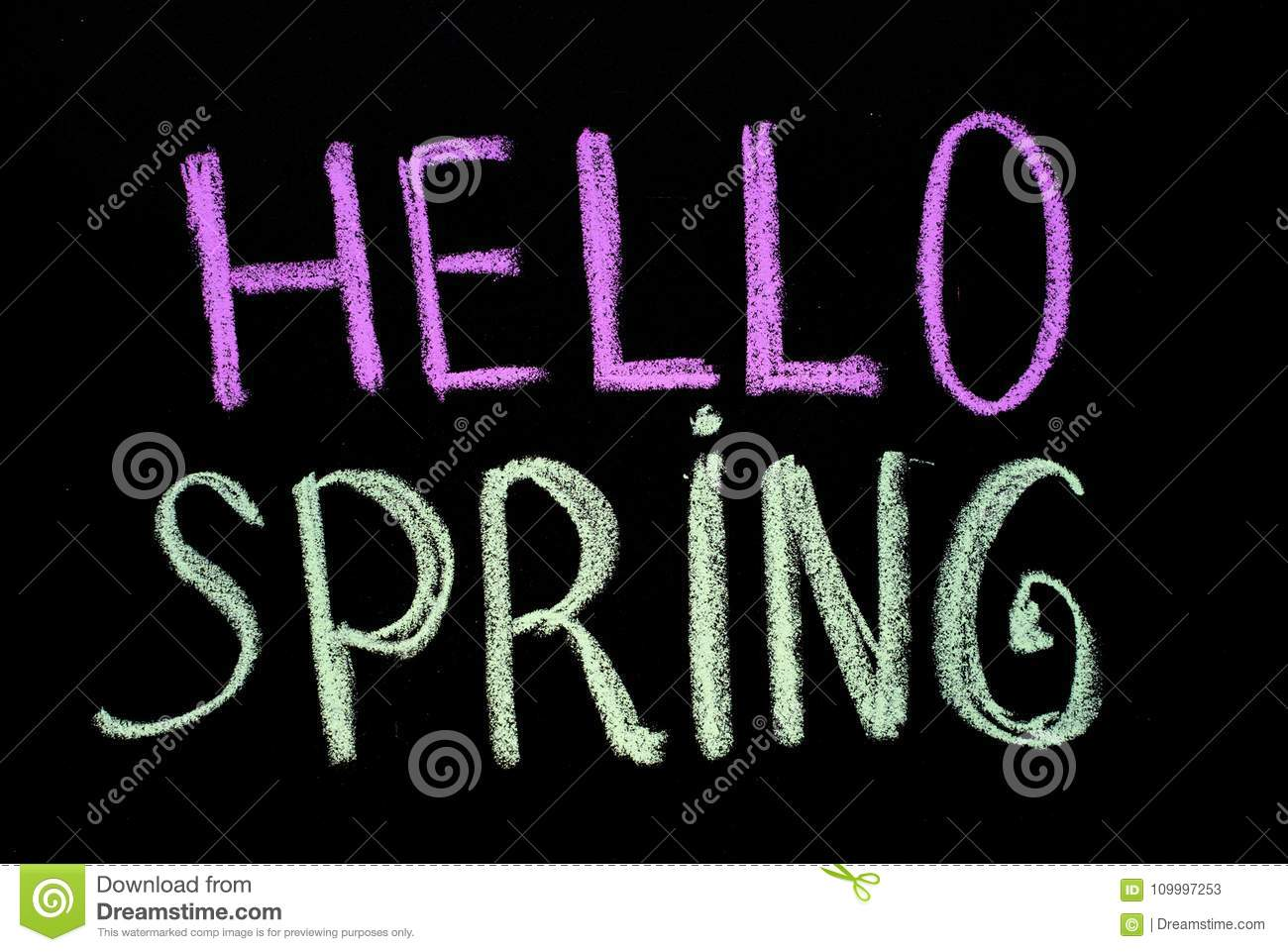 Chalk drawing text `hello spring` on blackboard