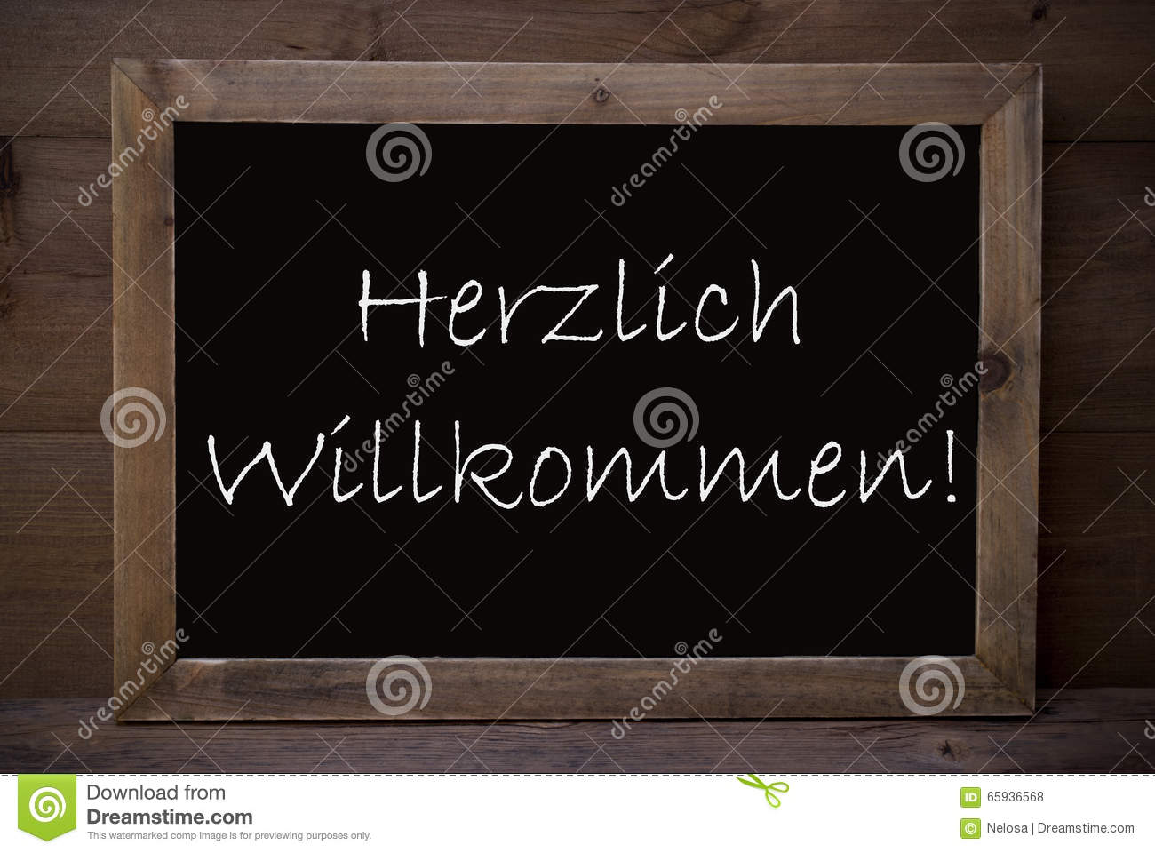Chalkboard With Herzlich Willkommen Means Welcome Stock Photo ...