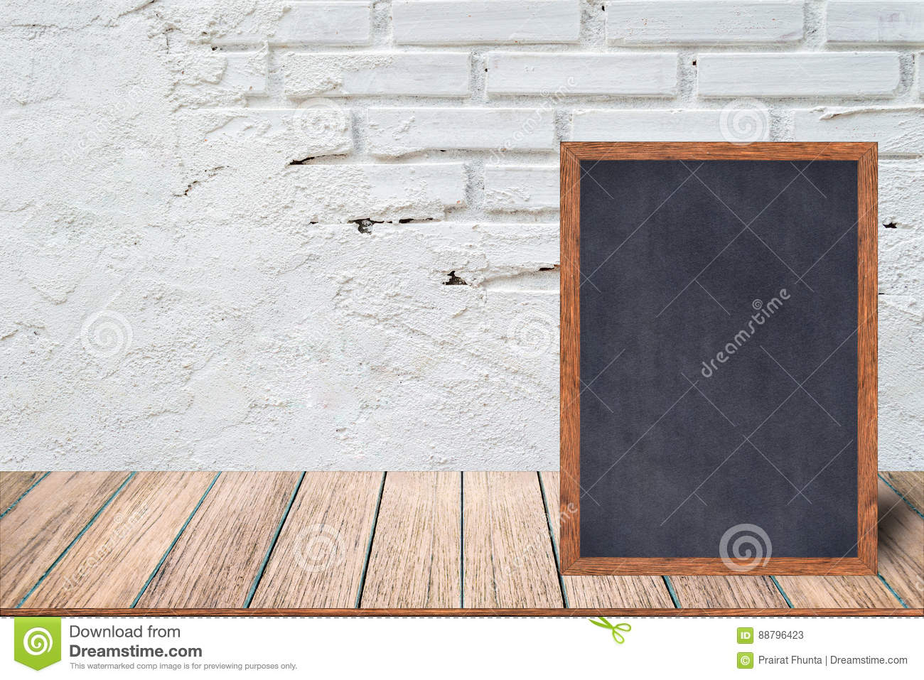 Chalkboard wood frame, blackboard sign menu on wooden table and with brick background.