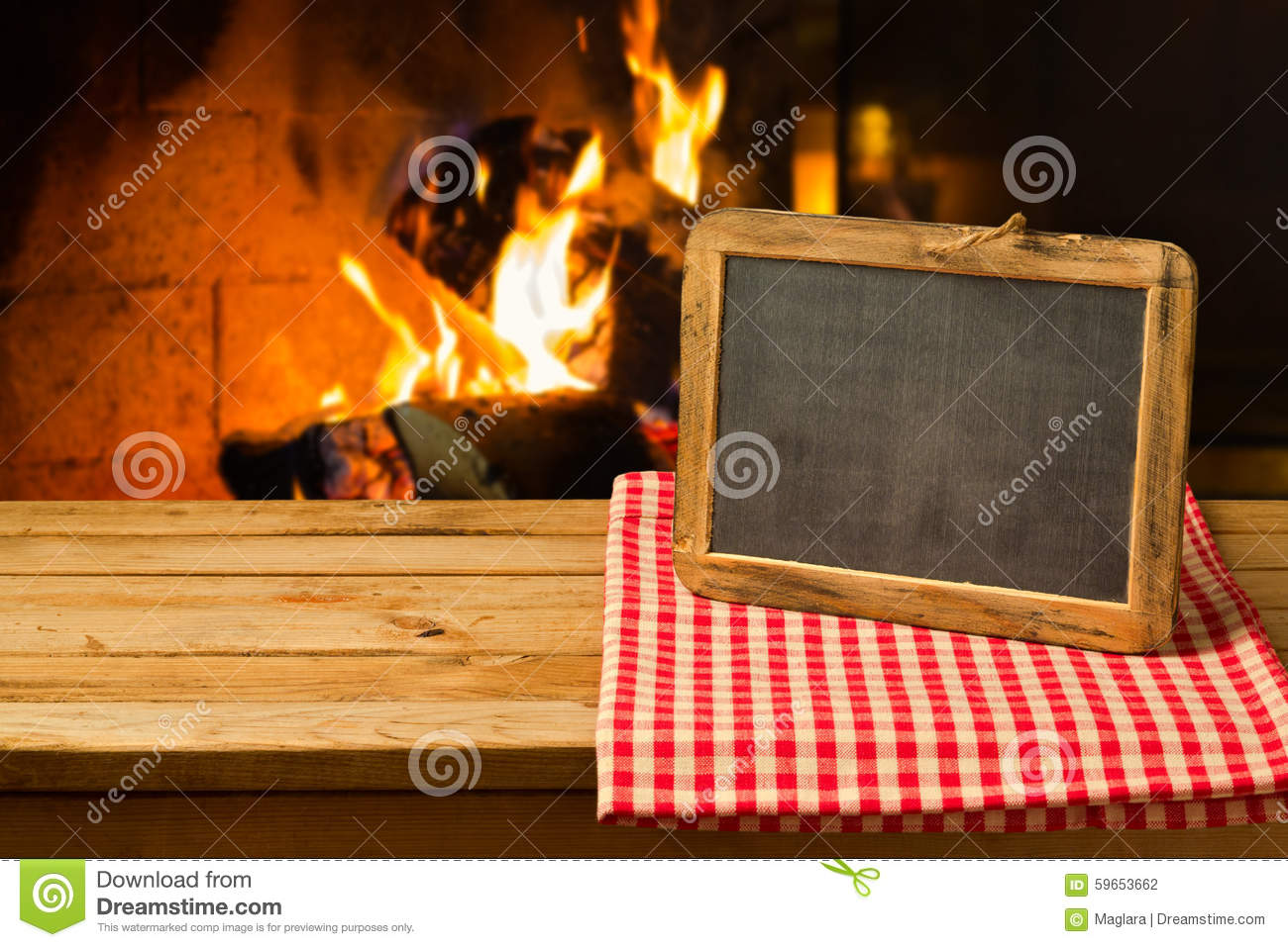 chalkboard on wooden table over fireplace background winter and