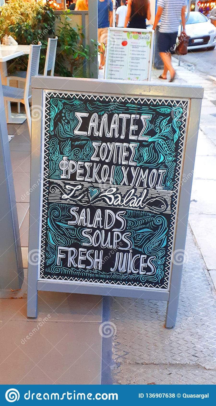 Chalked menu of a Restaurant near the harbour in the city of Rhodes