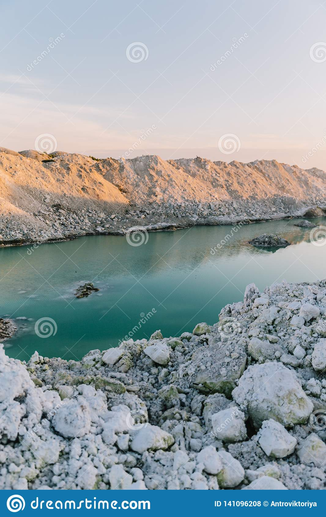 Mountain lake with emerald water at sunset