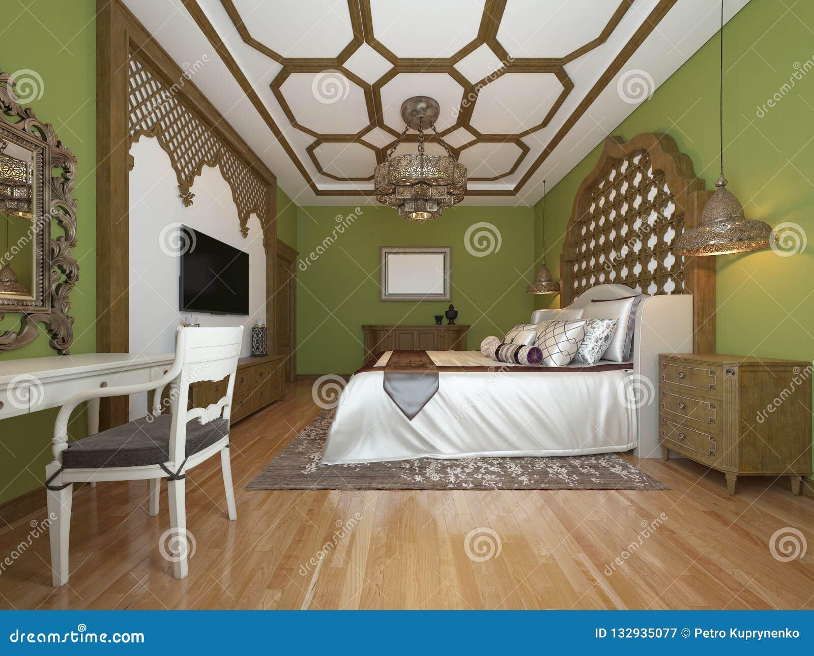 Chambre à coucher orientale dans le style arabe, avec une tête de lit en bois et des murs verts Unité de TV, coiffeuse, fauteuil