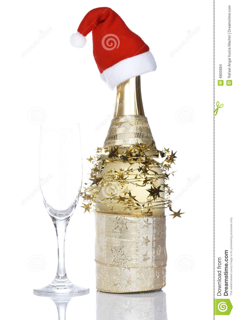 champagne bottle with red christmas hat stock photo