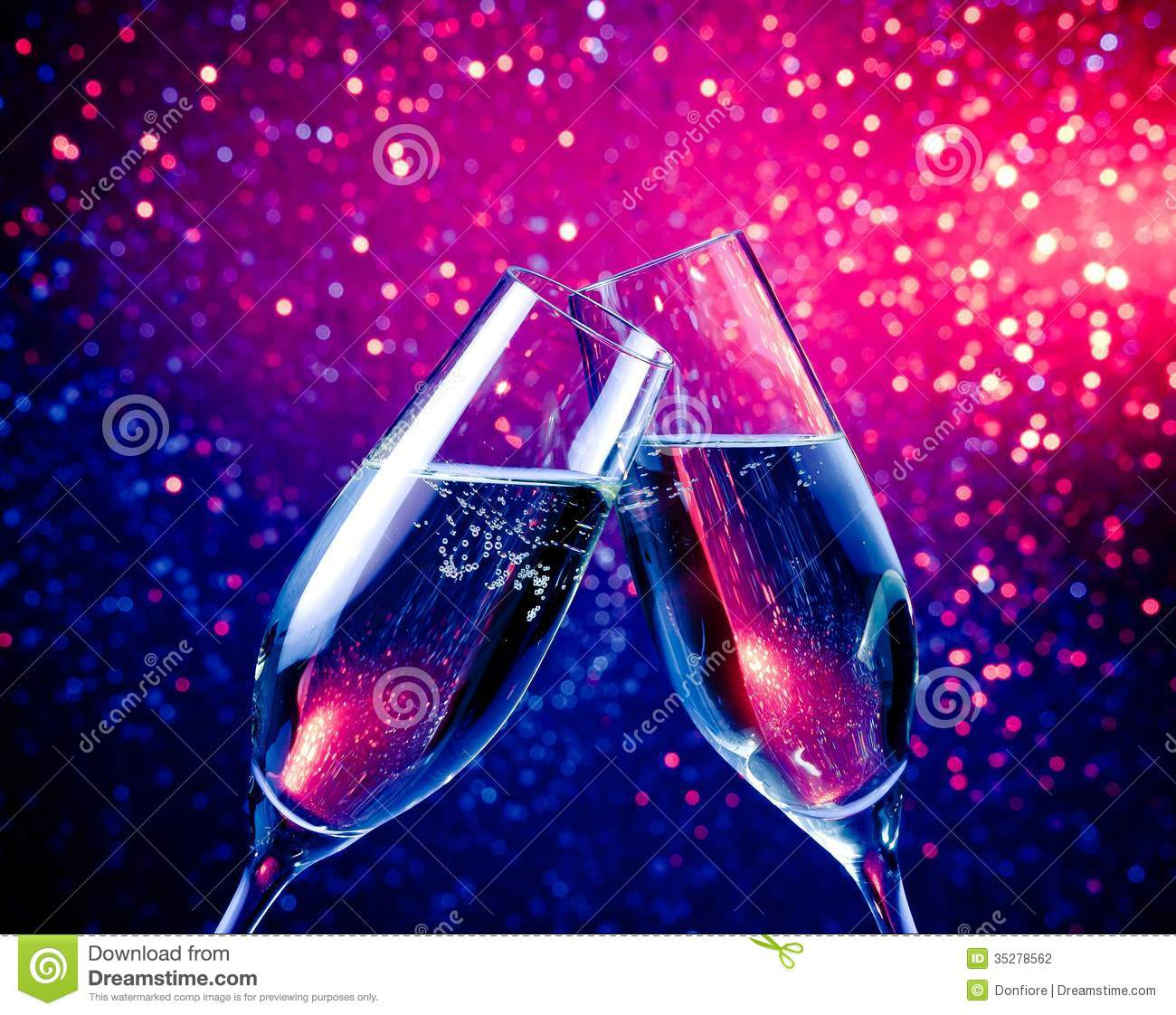 Champagne Flutes With Bubbles On Blue Tint Light Bokeh