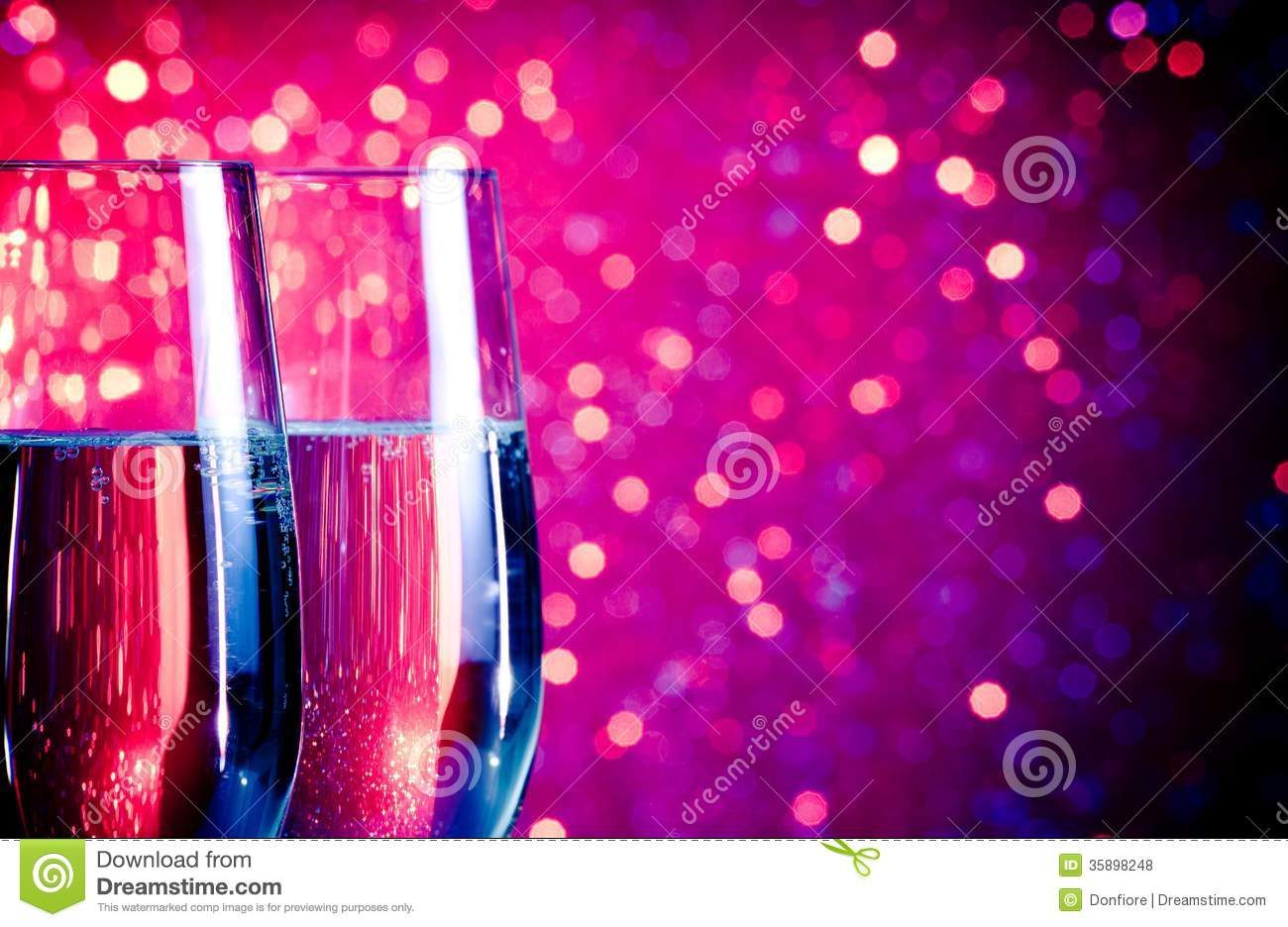 Champagne Flutes With Gold Bubbles On Blue And Violet Tint