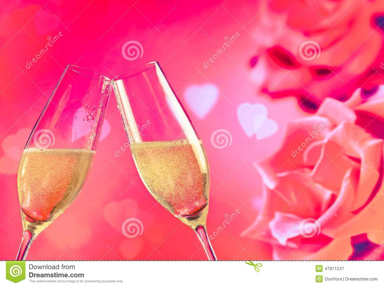 Champagne Flutes With Golden Bubbles On Roses Flowers