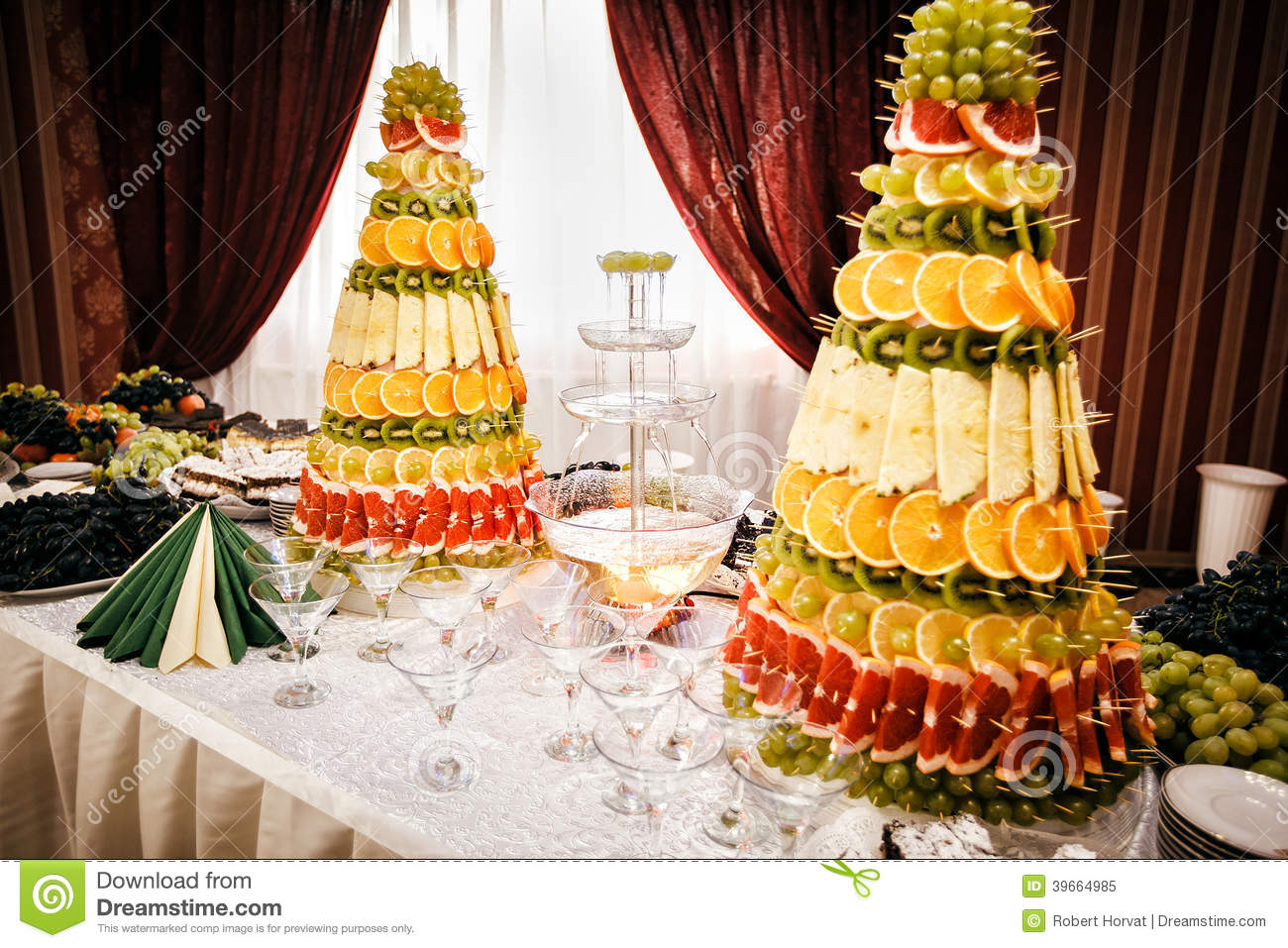 Champagne Fountain And Decorations From Fruit On Table