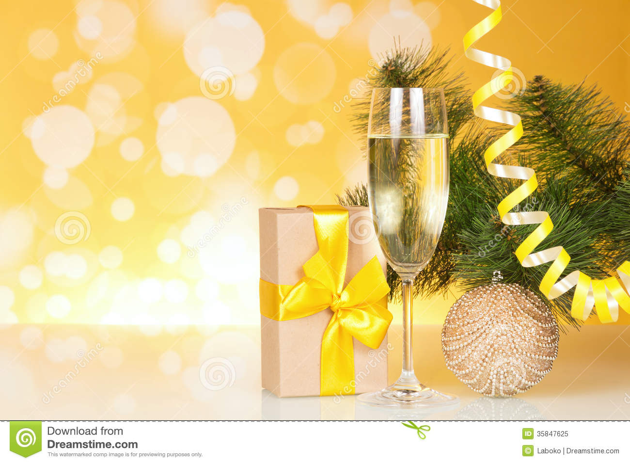Champagne With Gift And Christmas Tree Royalty Free Stock
