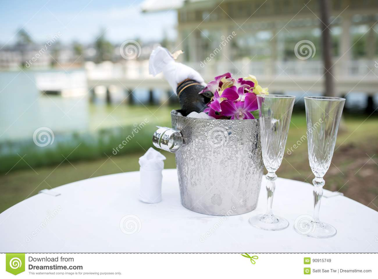 Champagne and a glass of champagne on the table for the wedding