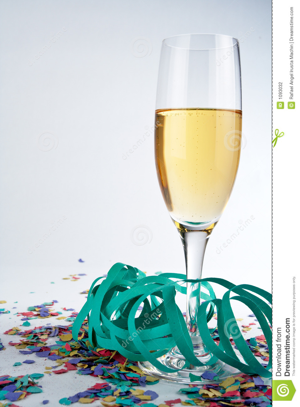 Champagne Glass, Ribbons And Confetti Stock PhotographyImage