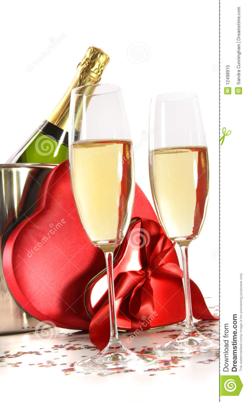 Champagne Glasses With Valentine Gifts On White Stock