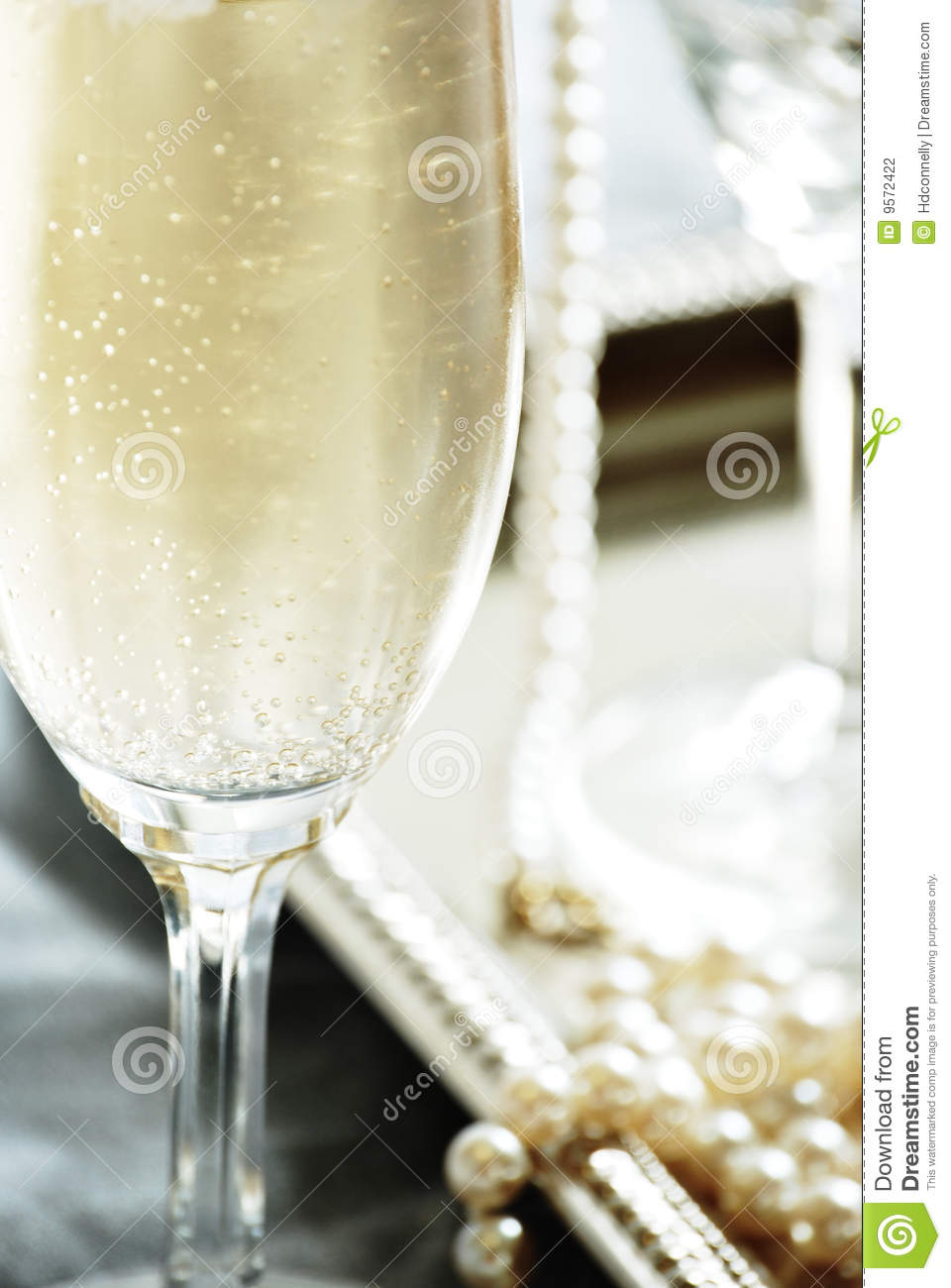 champagne and pearls stock photography