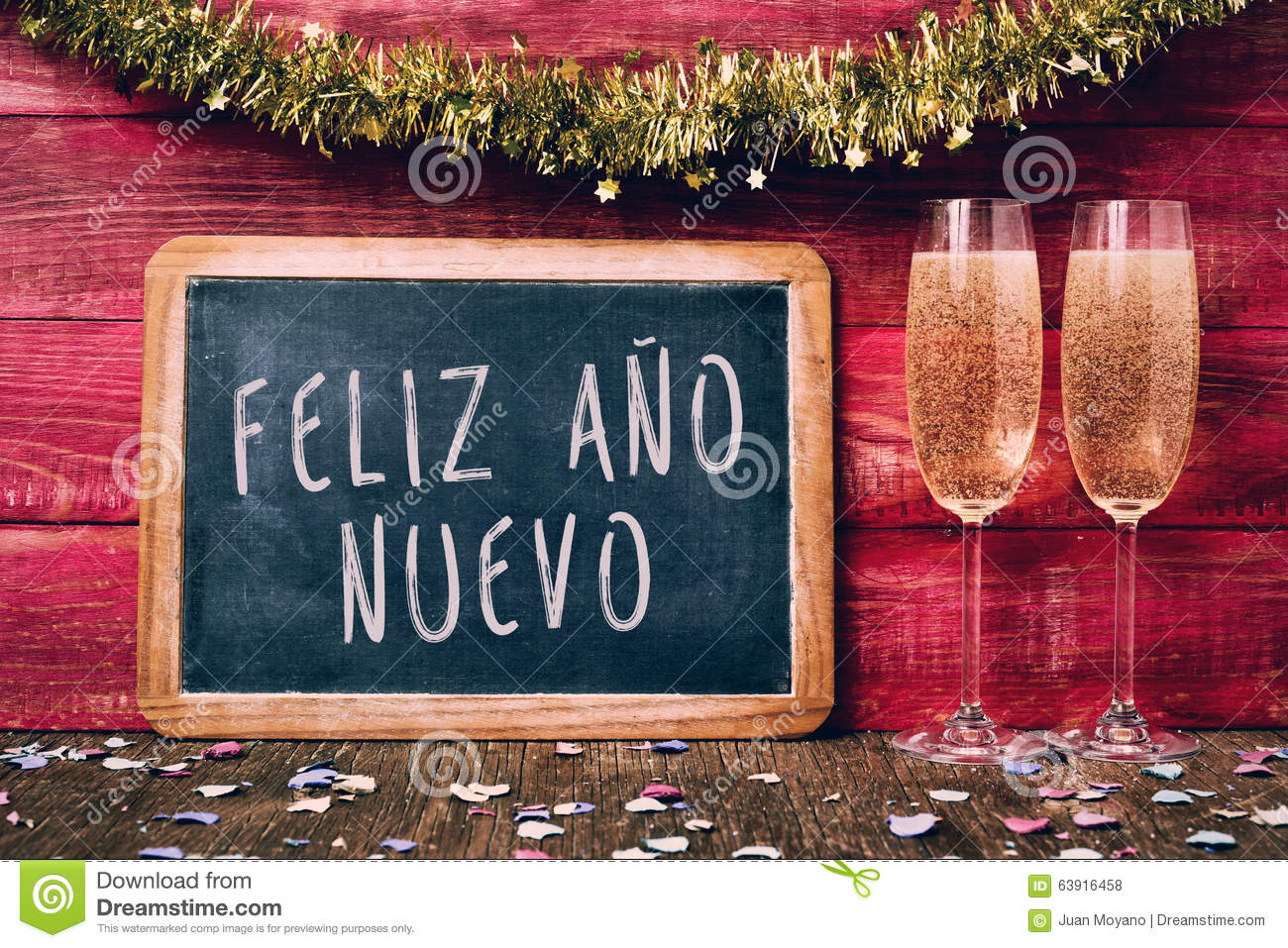 champagne and text feliz ano nuevo happy new year in spanish