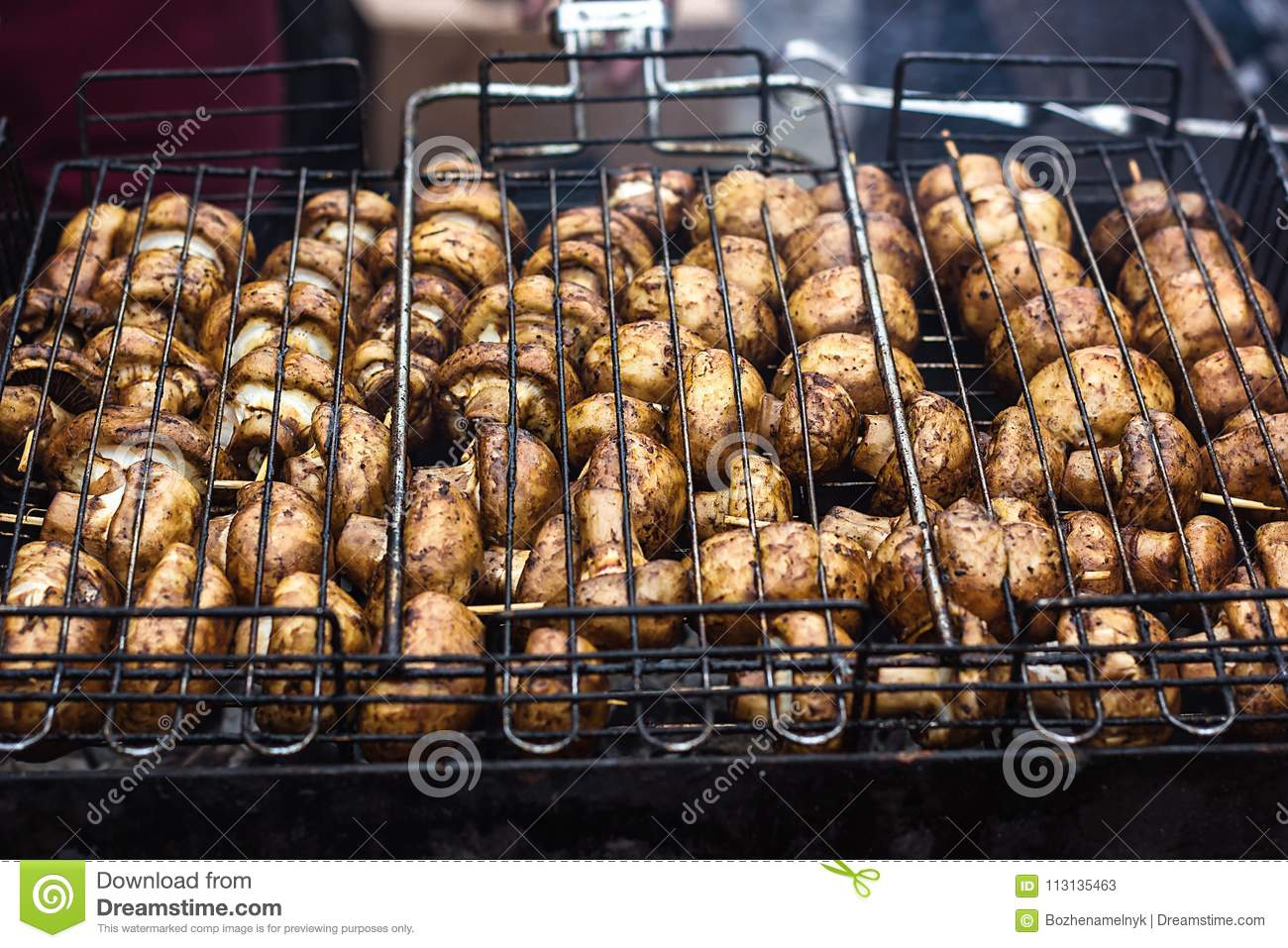 a94103cd2e4b Champignon white mushrooms grilled on grill or BBQ steam and small drops of  water. Cooking