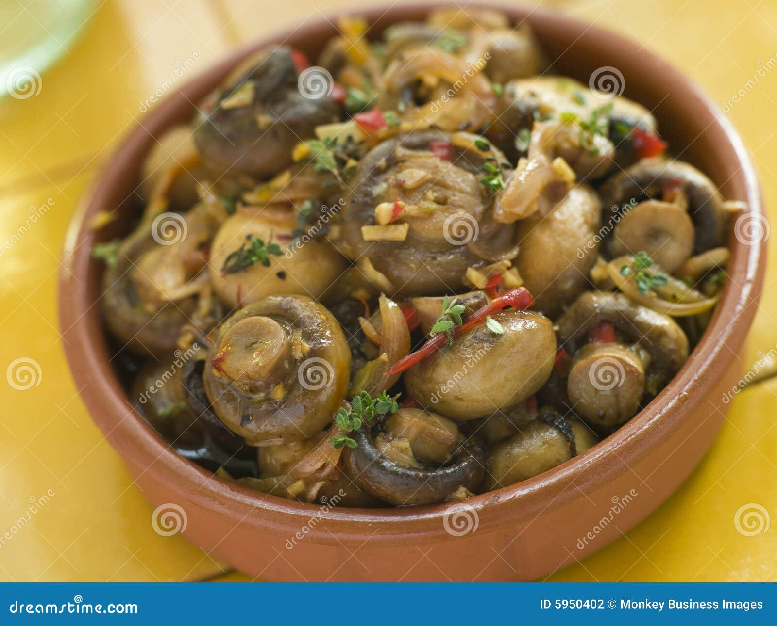 Champignons de couche marinés par ail de s/poivron