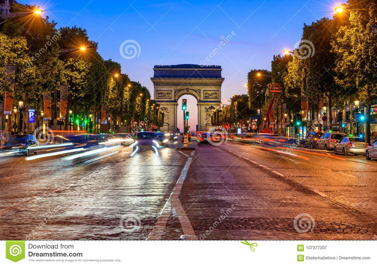 champs elysees and arc de triomphe at night in paris editorial