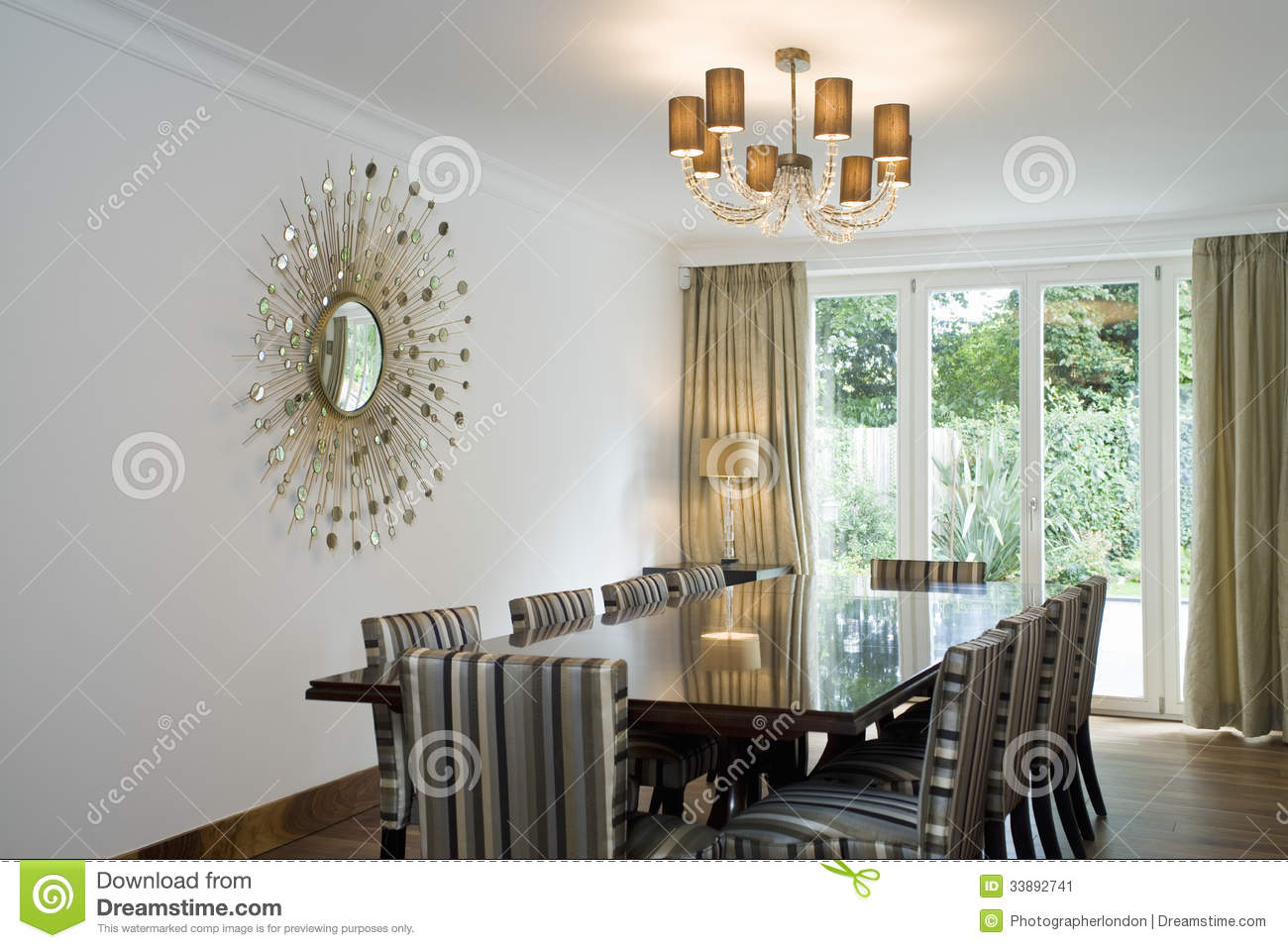 Chandelier Over Dining Table And Art On Wall Stock Image Of Simplicity