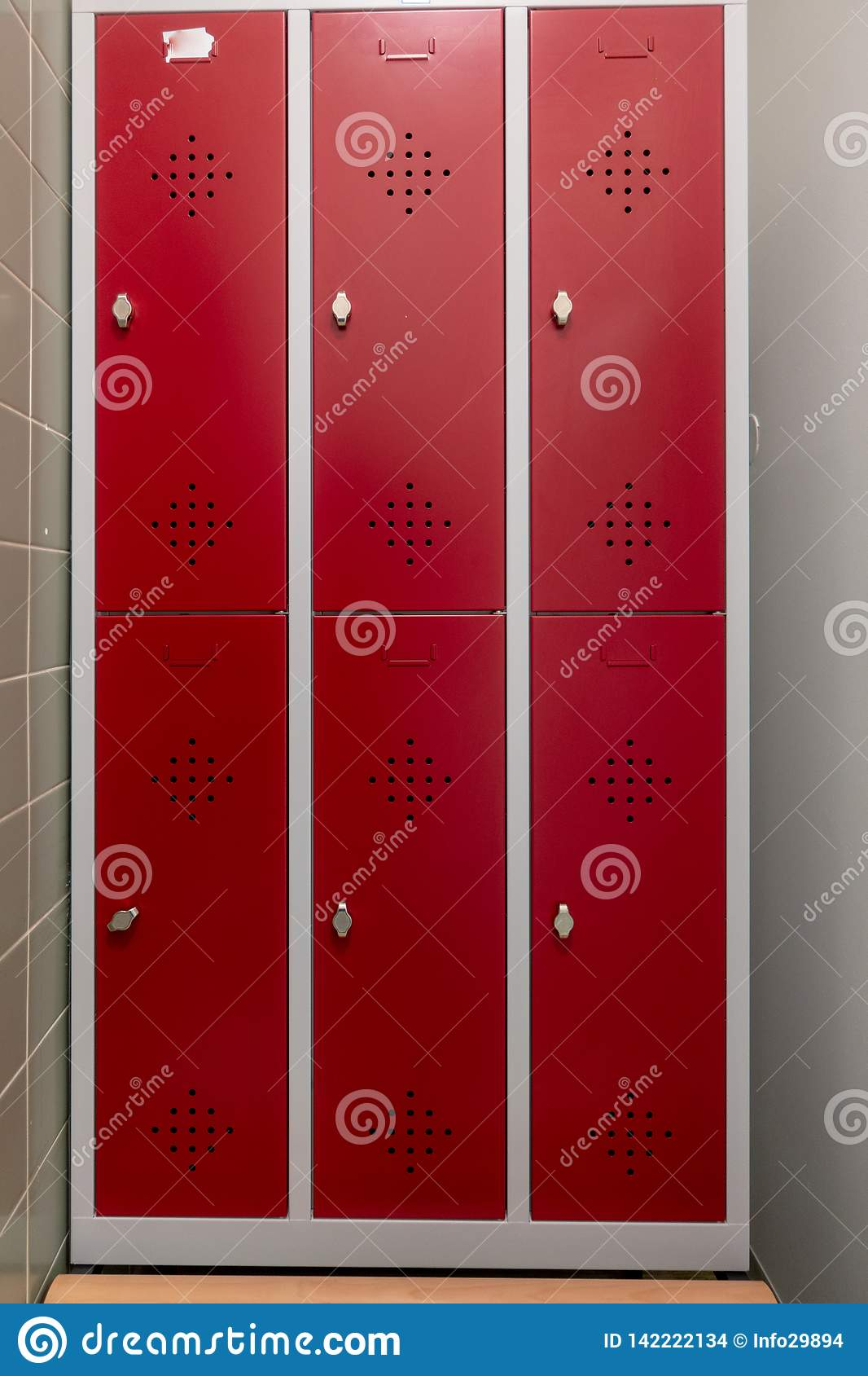 Changing lockers with red doors